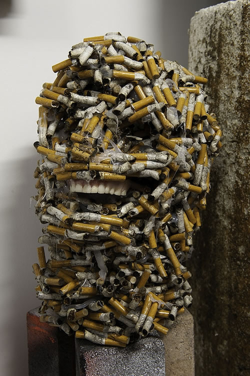 Head Sculpture Made From Used Cigarette Butts